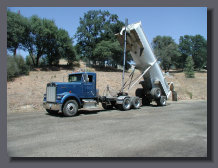 Semi end dump in full raised position